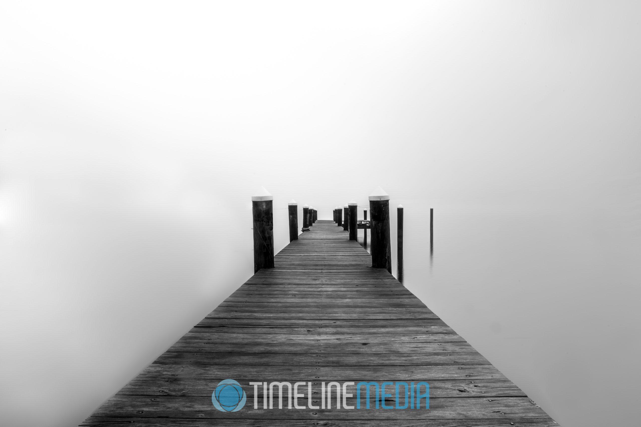 Pier under a cover of fog ©TimeLine Media