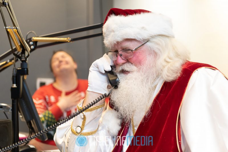 Santa taking calls from radio listeners at 94.7 Fresh FM in Washington, DC