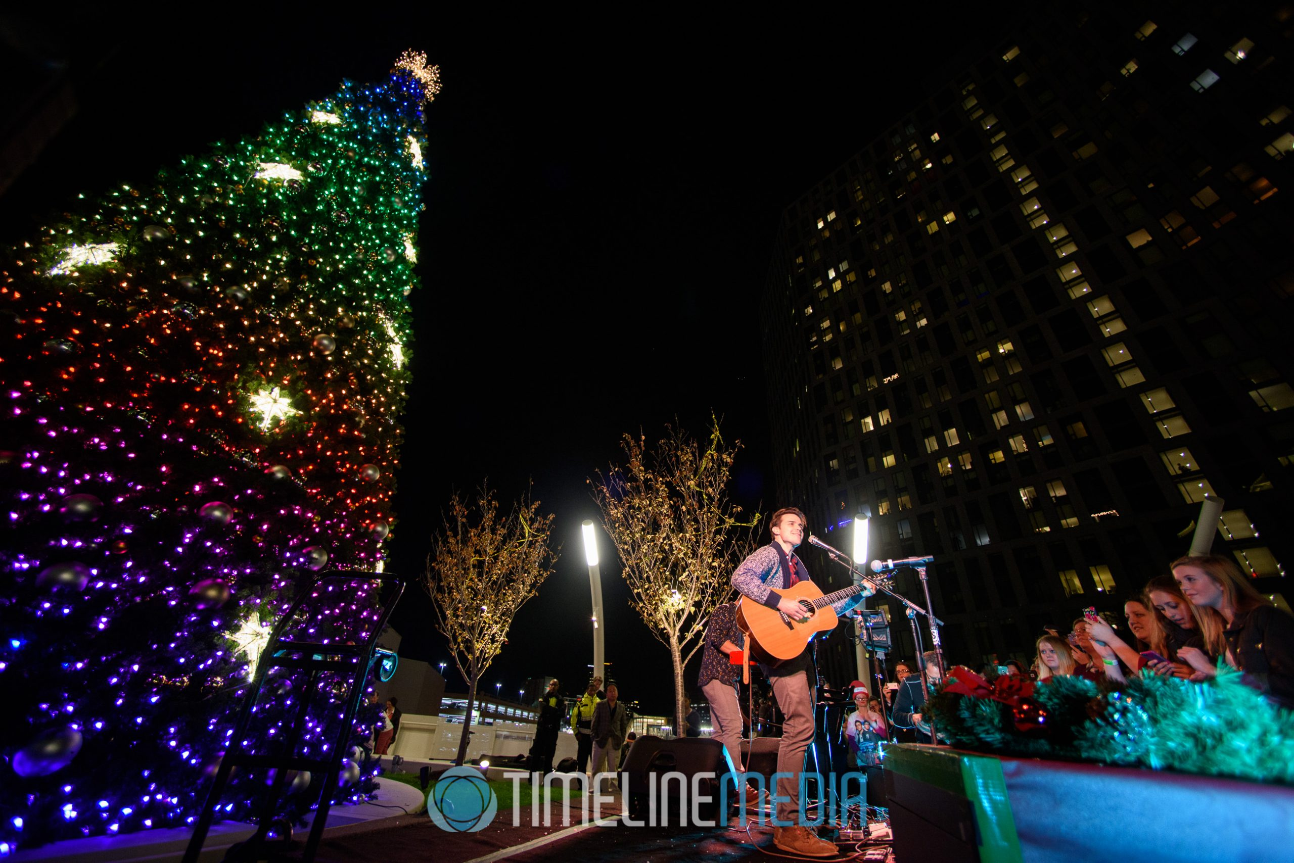 Kris Allen playing at the 2016 Christmas Tree Lighting Ceremony on the Plaza