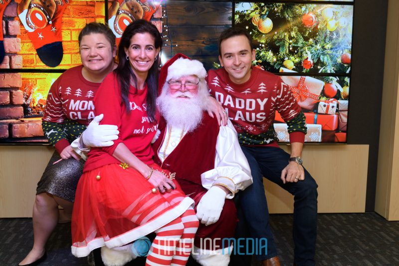 Jen, Kelly, and Tommy greeting Santa on their set at 94.7 Fresh FM in Washington, DC