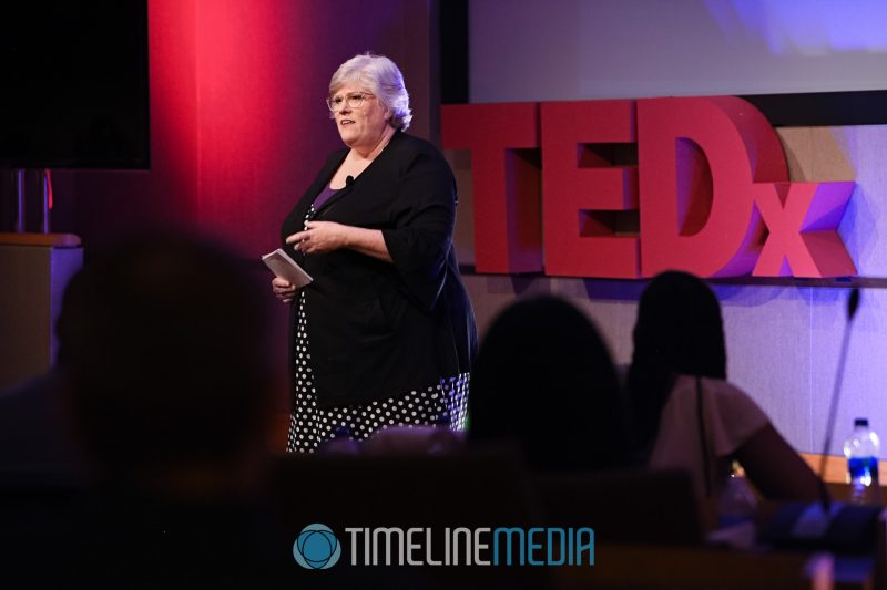 Kymberly Deloatche speaking at TEDxTysons ©TimeLine Media