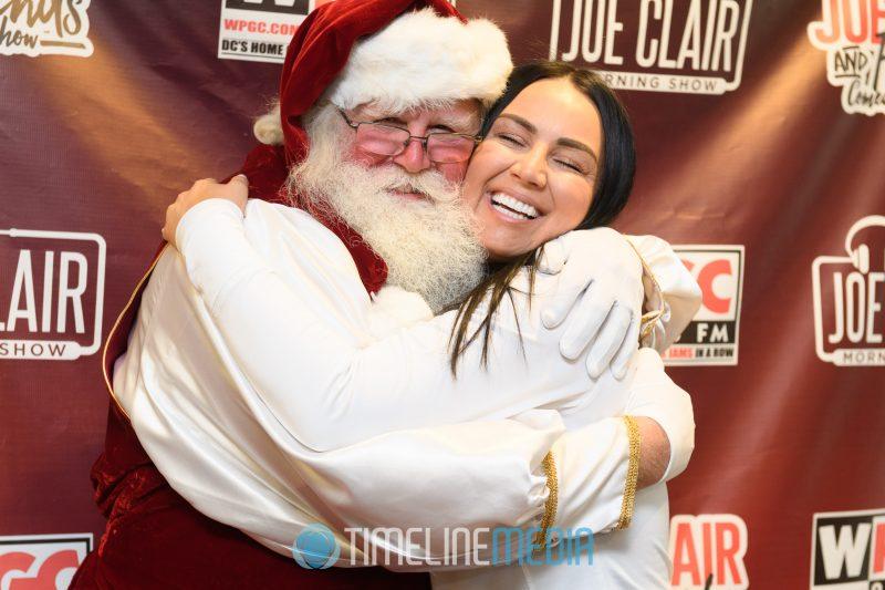 Santa giving hugs around the Entercom Radio offices in Washington, DC