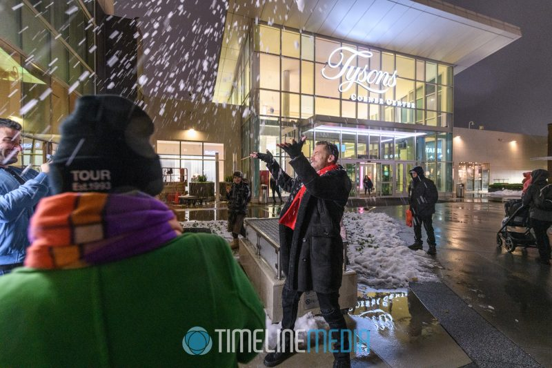 Lance Bass throwing a snow ball on the Plaza at Tysons Corner Center
