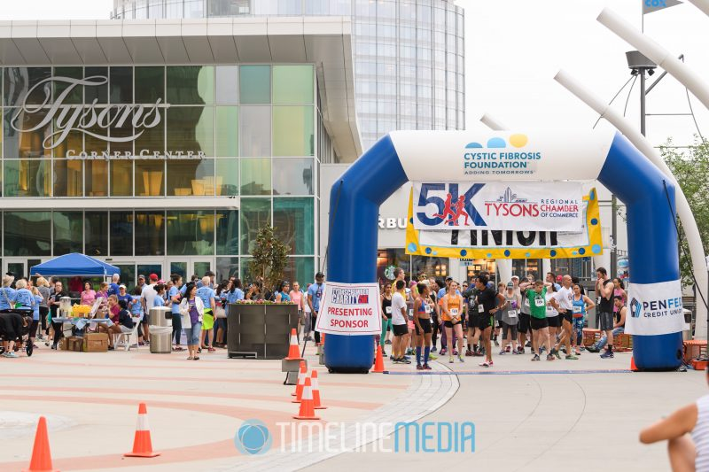 Runners gathering at the starting lane of the Tysons Chamber 5K ©TimeLine Media