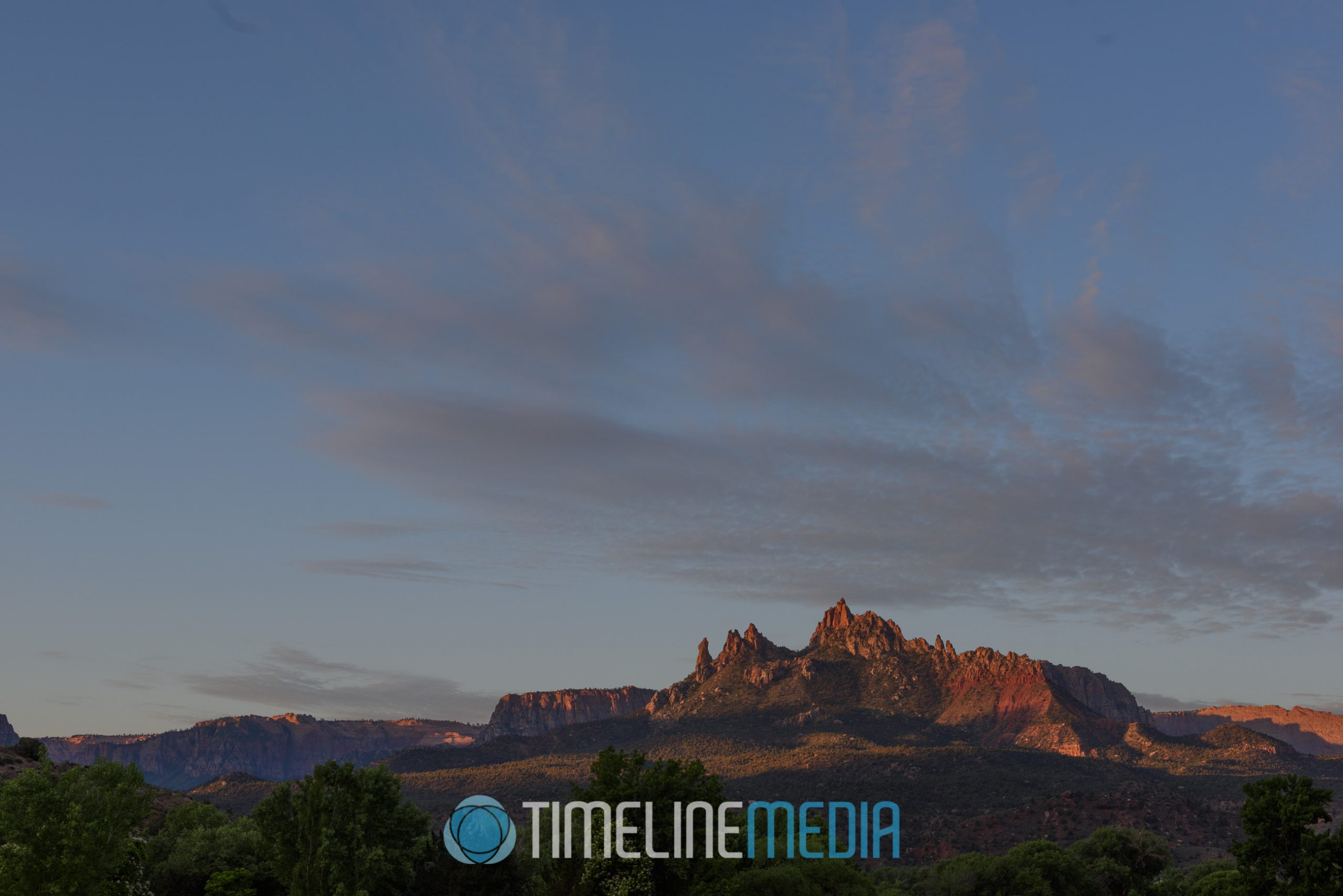 Early morning light on mountain top in Zion National Park ©TimeLine Media