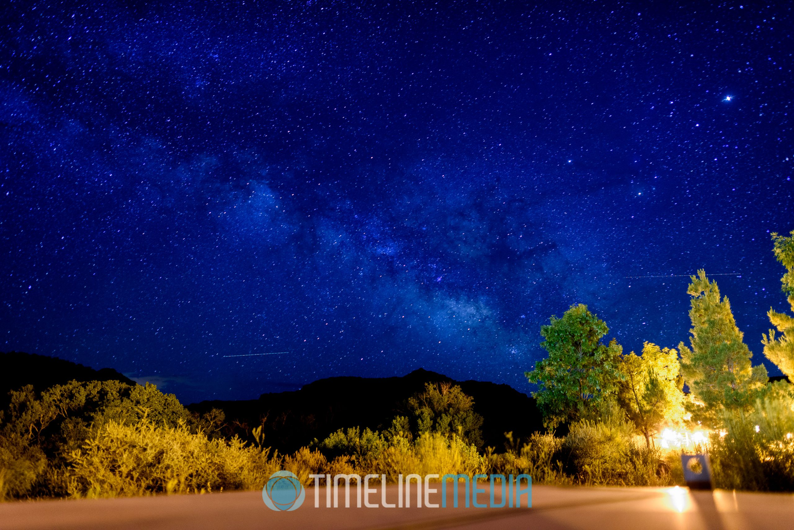 Milky Way galaxy center over dark skies ©TimeLine Media