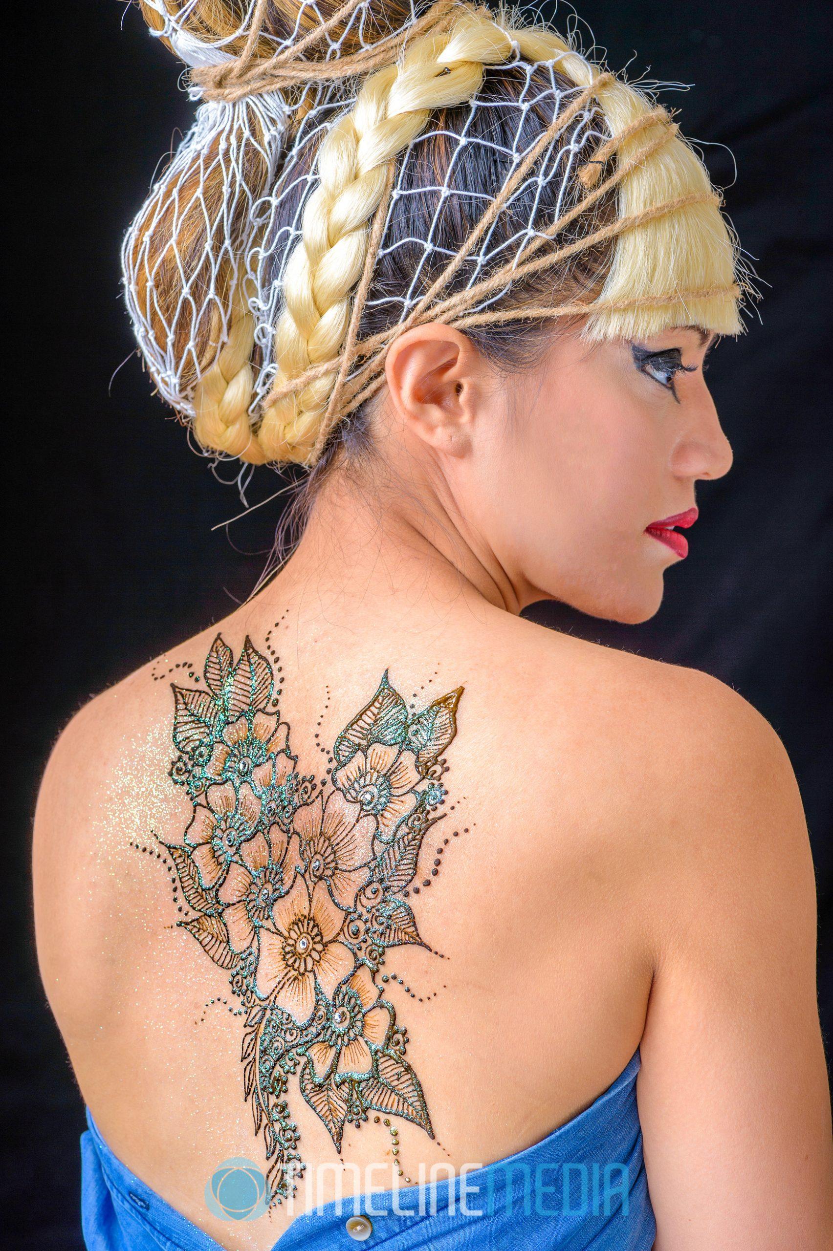 Model with henna applied ©TimeLine Media