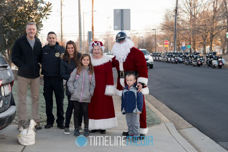 MPO Vazquez poses with a family before the Santa Ride with the Fairfax County Police ©TimeLine Media