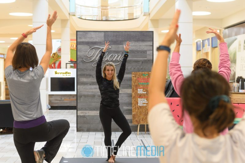 Practicing Yoga at an Athleta event at Tysons Corner Center