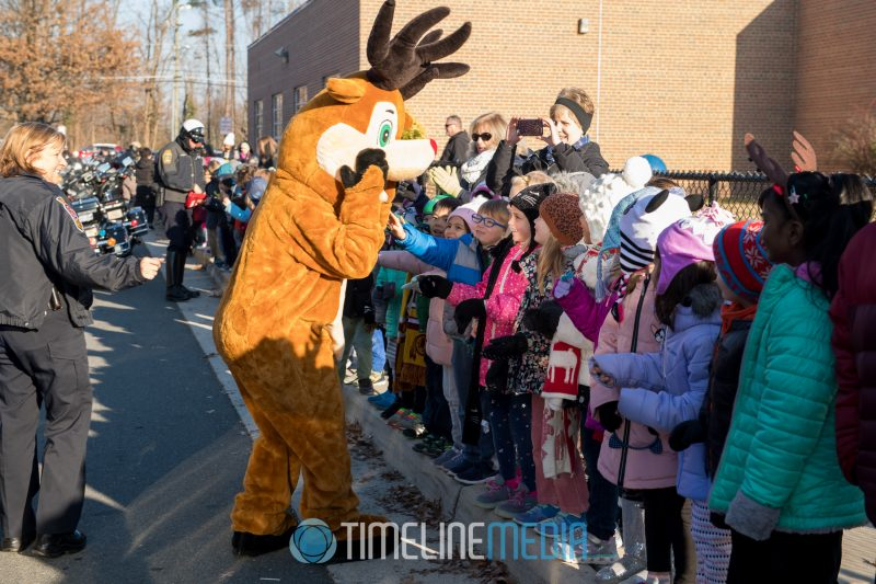 Rudolf greets school children during the Fairfax County police Santa Ride ©TimeLine Media