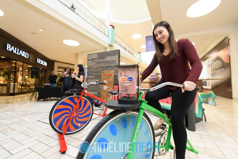 Ashley from Access Tysons uses the bicycle mixer at Tysons Corner Center