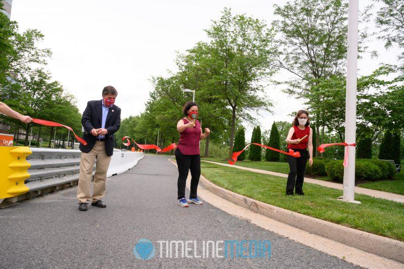 Supervisors Walter Alcorn, Dalia Palchik, and Tysons Partnership Roni Dancis cutting ribbon  ©TimeLIne Media