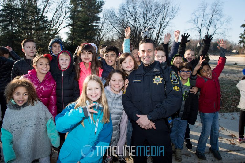 MPO Vazquez of the Town of Vienna police poses with kids during the Santa Ride ©TimeLine Media