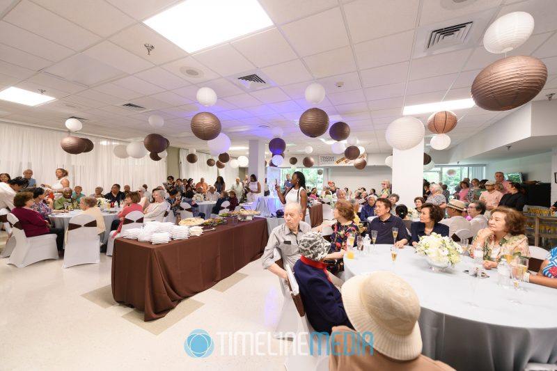 Reception room with residents celebrating the grand reopening of their residence in Tysons ©TimeLine Media