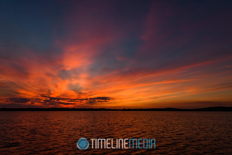 Clouds lit by the setting sun over Belmont Bay ©TimeLine Media