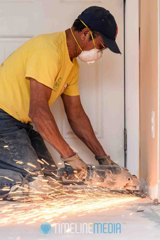 Noserale Home Improvement working on a sanding a floor with sparks ©TimeLine Media